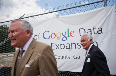 Nathan Deal, Tom Worthan A banner hangs on the fence at the site of a proposed $300 million expansion of Google's data center operations as Georgia Gov. Nathan Deal, left, and Douglas County Commissioner Tom Worthan, right, take a tour, in Lithia Springs, Ga. The new facility will be located next to the existing data center, one of 13 in the world, and will add 25 jobs to the 350 employees currently employed there by Google. The new facility is scheduled to be operational by the end of 2016