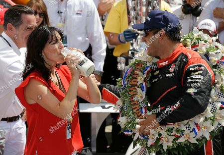 Stock Photo of Juan Pablo Montoya, Connie Montoya Connie Montoya takes a drink of milk as she celebrates with her husband, Juan Pablo Montoya, of Colombia, after he won the 99th running of the Indianapolis 500 auto race at Indianapolis Motor Speedway in Indianapolis