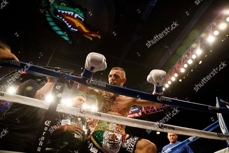 Jose Pedraza Andrey Klimov Ivan Redkach leans over the ropes after being defeated by Dejan Zlaticanin during the WBC lightweight eliminator boxing match, in Birmingham, Ala