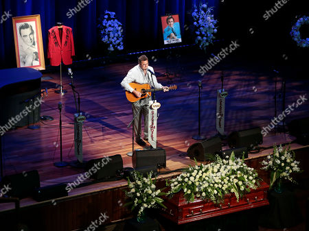 Vince Gill Vince Gill performs during the funeral service for country music performer Jim Ed Brown at the Ryman Auditorium, in Nashville, Tenn. Behind Gill are photos of Brown and a jacket worn by Brown during his performances. Brown, who was a member of the Grand Ole Opry and was recently elected to the Country Music Hall of Fame, died June 11. He was 81