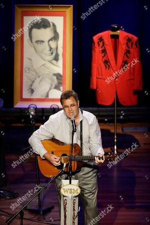 Vince Gill Vince Gill performs during the funeral service for country music performer Jim Ed Brown at the Ryman Auditorium, in Nashville, Tenn. Behind Gill are a photo of Brown and a jacket worn by Brown during his performances. Brown, who was a member of the Grand Ole Opry and was recently elected to the Country Music Hall of Fame, died June 11. He was 81