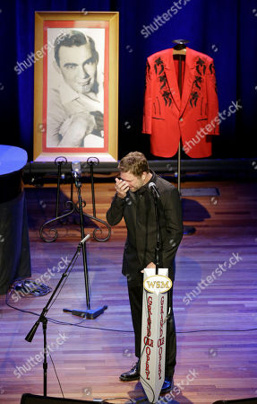 Craig Morgan Craig Morgan wipes away tears as he performs during the funeral service for country music performer Jim Ed Brown at the Ryman Auditorium, in Nashville, Tenn. Brown, who was a member of the Grand Ole Opry and was recently elected to the Country Music Hall of Fame, died June 11. He was 81