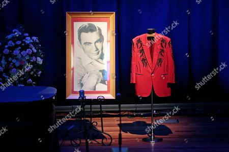 A portrait and a jacket are displayed on the stage during the funeral service for country music performer Jim Ed Brown at the Ryman Auditorium, in Nashville, Tenn. Brown, who was a member of the Grand Ole Opry and was recently elected to the Country Music Hall of Fame, died June 11. He was 81