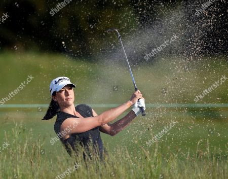 Stock Image of Paige Mackenzie Paige Mackenzie hits from a bunker on the 11th hole during the first round of the ShopRite LPGA Classic golf tournament, in Galloway Township, N.J