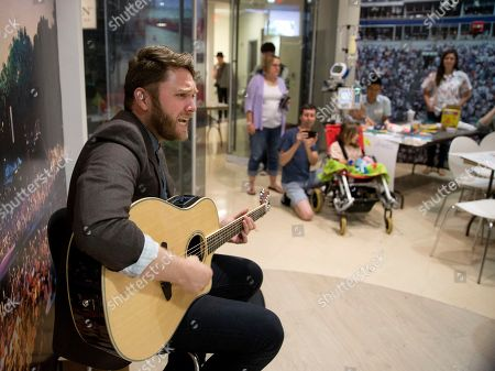 Recording artist Luke Wade performs for patients and families at Childern's Healthcare of Atlanta at Scottish children's hospital, in Atlanta, Ga