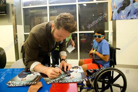 Luke Wade, Domimick Herbert Recording artist Luke Wade signs an autograph for Domimick Herbert as he visits patients and families at Children's Healthcare of Atlanta at Scottish Rite, in Atlanta