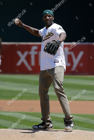 Festus Ezeli Golden State Warriors center Festus Ezeli throws out the ceremonial first pitch before a baseball game between the Oakland Athletics and the Seattle Mariners in Oakland, Calif