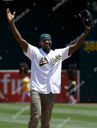 Festus Ezeli Golden State Warriors center Festus Ezeli gestures after throwing out the ceremonial first pitch before a baseball game between the Oakland Athletics and the Seattle Mariners in Oakland, Calif