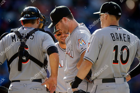 Bryan Morris, Jeff Mathis, Martin Prado, Jeff Baker Miami Marlins relief pitcher Bryan Morris, center, waits to be pulled from the mound after he injured himself while striking out Colorado Rockies' Wilin Rosario in the sixth inning of a baseball game, in Denver. From left to right, Marlins catcher Jeff Mathis, third baseman Martin Prado and first baseman Jeff Baker look on
