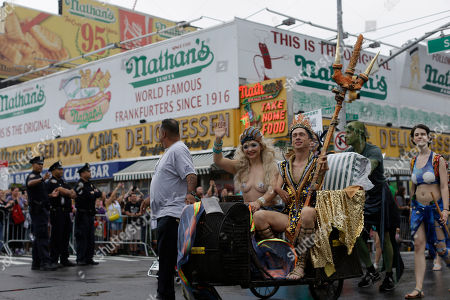 Mat Fraser, Julie Atlas Muz Neptune King Mat Fraser and Mermaid Queen Julie Atlas Muz march on Surf Ave during the 33rd annual Mermaid Parade, in Coney Island in the Brooklyn borough of New York