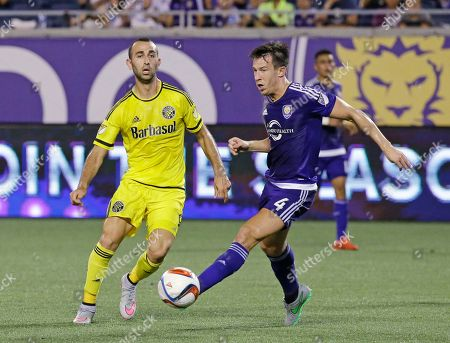 Justin Meram, Sean St. Ledger Columbus Crew forward Justin Meram, left, and Orlando City's Sean St. Ledger (4) battle for possession of the ball during the second half of an MLS soccer game, in Orlando, Fla. Orlando City won 2-0