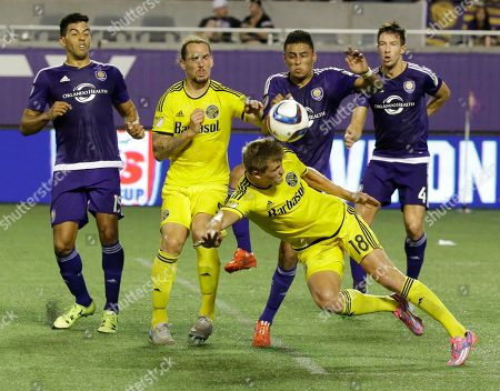 Aaron Schoenfeld, Danny Mwanga, Sean St. Ledger Columbus Crew forward Aaron Schoenfeld (18) attempts to head the ball towards the goal as Orlando City 's Danny Mwanga, left, and Sean St. Ledger (4) try to defend during the second half of an MLS soccer game, in Orlando, Fla. Orlando City won 2-0