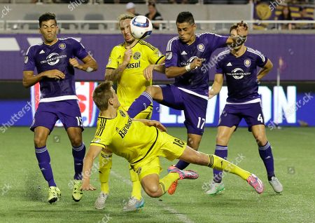 Aaron Schoenfeld, Danny Mwanga, Sean St. Ledger Columbus Crew forward Aaron Schoenfeld (18) attempts to head the ball towards the goal as Orlando City 's Danny Mwanga, left, Darwin Ceren (17) and Sean St. Ledger (4) try to defend during the second half of an MLS soccer game, in Orlando, Fla. Orlando City won 2-0