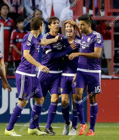 Sean St. Ledger, Luke Boden, Kaka, Pedro Ribeiro Orlando City SC defender Sean St. Ledger, second from right, celebrates with defender Luke Boden, left, forward Kaka and forward Pedro Ribeiro, right, after scoring his goal during the first half of an MLS soccer game against the Chicago Fire, in Bridgeview, Ill
