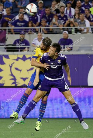 Marcelo Sarvas, Sean St. Ledger Colorado Rapids midfielder Dillon Powers, left, goes after the ball against Orlando City's Sean St. Ledger (4) during the first half of an MLS soccer game, in Orlando, Fla