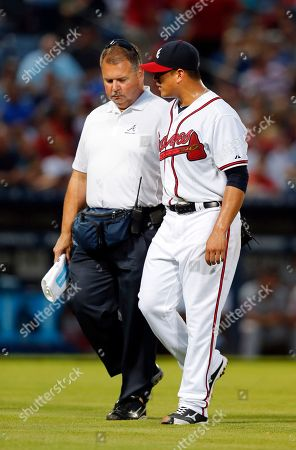 Manny Banuelos, Jim Lovell Atlanta Braves starting pitcher Manny Banuelos walks off the field with athletic trainer Jim Lovell during the fifth inning of a baseball game against the Washington Nationals, in Atlanta