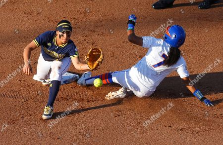 Kelsey Stewart, Sierra Romero Florida's Kelsey Stewart (7) slides safely into second base as Michigan second baseman Sierra Romero takes the throw during the second inning of the final game in the NCAA softball Women's College World Series, in Oklahoma City