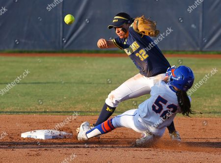 Justine McLean, Sierra Romero Florida's Justine McLean (52) slides safely into second base as the ball gets away from Michigan second baseman Sierra Romero during the second inning of the final game in the NCAA softball Women's College World Series, in Oklahoma City