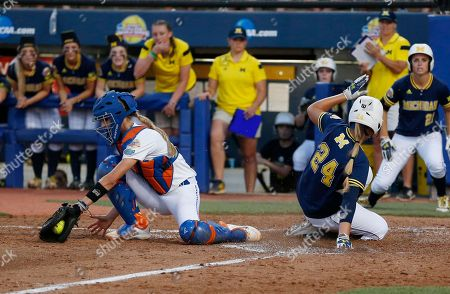 Stock Picture of Tera Blanco, Aubree Munro Michigan's Tera Blanco (24) scores behind Florida catcher Aubree Munro on a single by Sierra Romero in the fifth inning of the final game in the NCAA softball Women's College World Series, in Oklahoma City. Florida won 4-1
