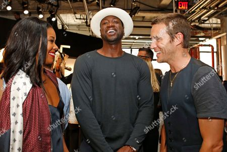 Gabrielle Union, Dywayne Wade, David Neville Actress Gabrielle Union, her husband, Miami Heat guard Dywayne Wade, center, and designer David Neville share a laugh during the Rag and Bone Spring/Summer 2016 presentation at Men's Fashion Week in New York