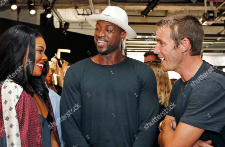 Gabrielle Union, Dywayne Wade, David Neville Actress Gabrielle Union, her husband, Miami Heat guard Dywayne Wade, center, and designer David Neville chat during the Rag and Bone Spring/Summer 2016 presentation at Men's Fashion Week in New York