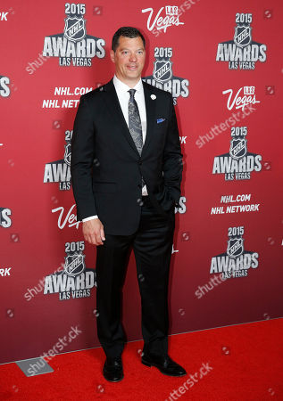 Bill Guerin poses on the red carpet before the NHL Awards show, in Las Vegas
