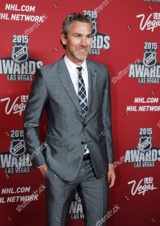 Trevor Linden poses on the red carpet before the NHL Awards show, in Las Vegas