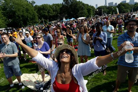 Raquel Jimenez, who is originally from Puerto Rico and lives in Brooklyn, worships during the NY CityFest in Central Park, in New York. Organizers estimate 60,000 people will be on the Great Lawn of Central Park to see evangelist Luis Palau preach