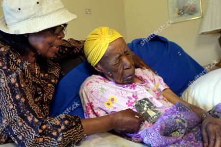 Susannah Mushatt Jones, Lois Judge Lois Judge, left, holds a 1939 photo of her aunt Susannah Mushatt Jones, right, during an interview in Jones' room at the Vandalia Avenue Houses, in the Brooklyn borough of New York. Jones, the world's oldest person, has died in New York at age 116. Robert Young, a senior consultant for the Gerontology Research Group, says Jones died at a senior home in Brooklyn Thursday night, May 12, 2016. He said she had been ill for the past 10 days