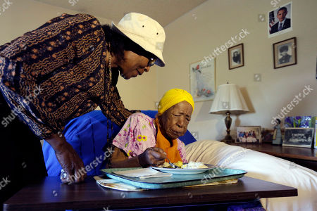 Susannah Mushatt Jones, Lois Judge FILE - In this photo, Lois Judge, left, helps her aunt Susannah Mushatt Jones, during breakfast in Jones' room at the Vandalia Avenue Houses, in the Brooklyn borough of New York. Jones, the world's oldest person, has died in New York at age 116. Robert Young, a senior consultant for the Gerontology Research Group, says Jones died at a senior home in Brooklyn Thursday night, May 12, 2016. He said she had been ill for the past 10 days
