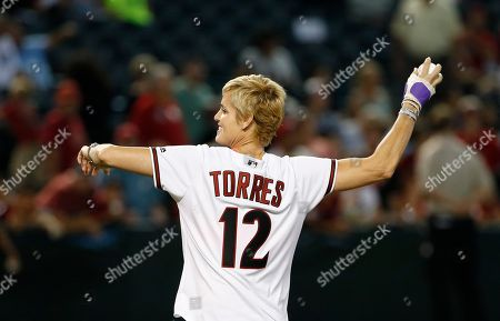 Dara Torres Former United States Olympic swimmer Dara Torres throws out the first pitch prior to a baseball game between the Arizona Diamondbacks and the San Diego Padres, in Phoenix