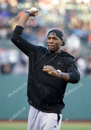 Festus Ezeli Golden State Warriors center Festus Ezeli, of Nigeria, throws out the ceremonial first pitch before the start of a baseball game between the San Francisco Giants and the San Diego Padres, in San Francisco