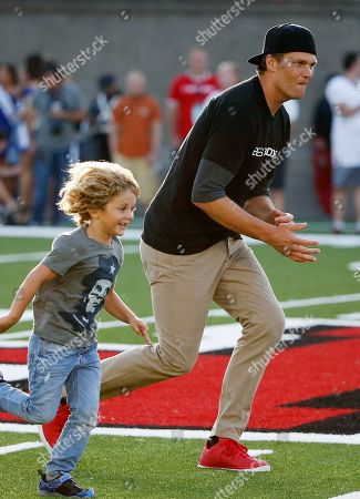 Tom Brady, Joseph Shriver Joseph Shriver, left, son of Anthony Kennedy Shriver, runs alongside New England Patriots' Tom Brady during the Best Buddies Challenge charity football game in Boston