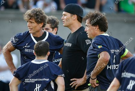 Tom Brady, Steve DiFillippo, Anthony Kennedy Shriver New England Patriots' Tom Brady, center, with Anthony Kennedy Shriver, left, and restaurateur Steve DiFillippo, right, during the Best Buddies Challenge charity football game in Boston
