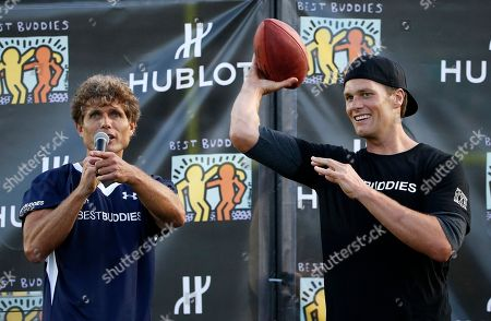 Tom Brady, Anthony Kennedy Shriver New England Patriots' Tom Brady, right, tosses a ball beside Anthony Kennedy Shriver during the Best Buddies Challenge charity football game in Boston