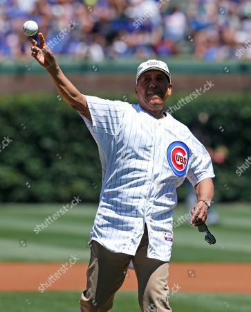 Stock Picture of Jose Cardenal Former Chicago Cubs outfielder Jose Cardenal throws out a ceremonial first pitch before a baseball game between the Pittsburgh Pirates and the Chicago Cubs, in Chicago