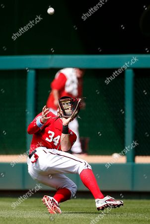 Bryce Harper Washington Nationals right fielder Bryce Harper (34) falls as he catches a fly ball hit by Pittsburgh Pirates' Corey Hart during the seventh inning of a baseball game at Nationals Park, in Washington. The Nationals won 9-2