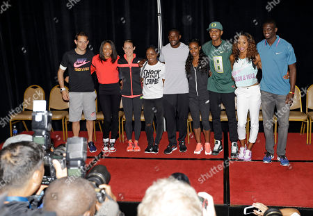 Renaud Lavillenie, Allyson Felix, Jenny Simpson, Shelly-Ann Fraser-Pryce, Justin Gatlin, Genzebe Dibaba, Mutaz Essa Barshim, Sanya Richards-Ross, Kirani James Competitors in the Prefontaine Classic track and field meet pose for photos during a press conference in Eugene, Ore., . They are, rom left, are Renaud Lavillenie, Allyson Felix, Jenny Simpson, Shelly-Ann Fraser-Pryce, Justin Gatlin, Genzebe Dibaba, Mutaz Essa Barshim, Sanya Richards-Ross and Kirani James