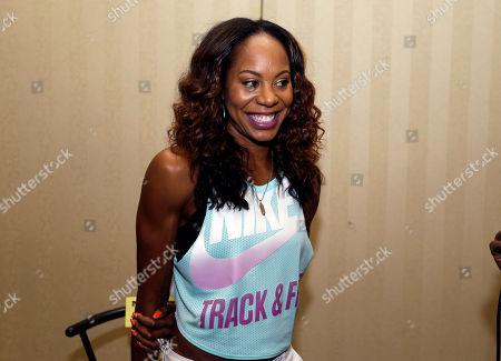 Sanya Richards-Ross Hurdler Sanya Richards-Ross smiles during an interview at a press conference for the Prefontaine Classic track and field meet in Eugene, Ore., . Richards-Ross will compete in the 400-meter race Saturday