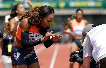 Stock Photo of Sanya Richards-Ross Sanya Richards-Ross playfully waves to the camera before competing in the 400-meter race during the Prefontaine Classic track and field meet in Eugene, Ore., . Richards-Ross finished second