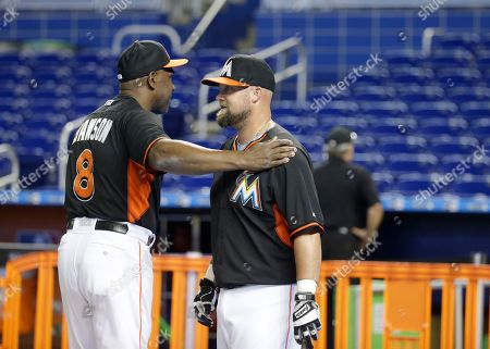 Andre Dawson, Casey McGehee Miami Marlins' Andre Dawson (8) talks with Casey McGehee, right, before a baseball game against the Miami Marlins, in Miami. The Marlins defeated the Reds 2-0