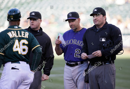 Tye Waller, Walt Weiss, Dan Bellino Colorado Rockies manager Walt Weiss, second from right, exchanges lineups with Oakland Athletics first base coach Tye Waller before the start of their baseball game, in Oakland, Calif. At right is home plate umpire Dan Bellino
