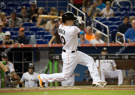 Jeff Baker Miami Marlins' Jeff Baker (10) hits a home run during the fifth inning of a baseball game in Miami against the Colorado Rockies
