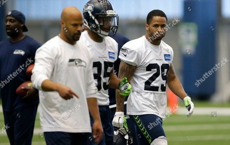 Earl Thomas Seattle Seahawks safety Earl Thomas, right, walks off the field with defensive coordinator Kris Richard, second from left, after an organized team activity, in Renton, Wash
