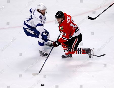 Stock Photo of Victor Hedman, Jonathan Toews Chicago Blackhawks' Jonathan Toews, right, handles the puck as Tampa Bay Lightning's Victor Hedman, of Sweden, defends during the first period in Game 3 of the NHL hockey Stanley Cup Final, in Chicago