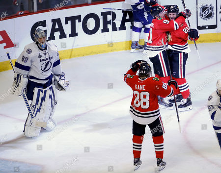 Brandon Saad, Patrick Kane, Brad Richards, Andrei Vasilevskiy Chicago Blackhawks' Brandon Saad, top right, is congratulated by teammate Brad Richards and Patrick Kane, bottom right, after scoring past Tampa Bay Lightning goalie Andrei Vasilevskiy, left, during the third period in Game 4 of the NHL hockey Stanley Cup Final, in Chicago