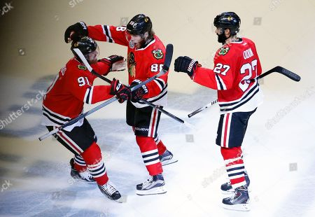 Johnny Oduya, Patrick Kane, Brad Richards Chicago Blackhawks' Patrick Kane, center, is congratulated by teammates Brad Richards, left, and Johnny Oduya, of Sweden, during the third period in Game 6 of the NHL hockey Stanley Cup Final series against the Tampa Bay Lightning, in Chicago