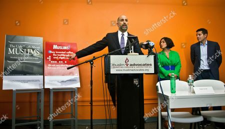 Muslim ads Muslim Advocates Legal Director Glenn Katon, left, and Muslim comedians Negin Farsad, center, and Dean Obeidallah, right, hold a press conference about a lawsuit challenging the Metropolitan Transportation Authority's refusal to run comedic ads about American Muslims like those displayed, in New York