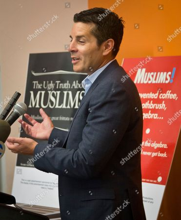 Stock Picture of Muslim ads Muslim comic Dean Obeidallah speak during a press conference about a lawsuit challenging the Metropolitan Transportation Authority's refusal to run comedic ads about American Muslims, in New York