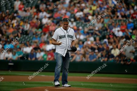 Jim Caviezel Actor Jim Caviezel throws out the first pitch of a baseball game between the Seattle Mariners and the Detroit Tigers, in Seattle